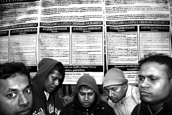 Bangladeshi people at the beginning of a demonstration in Esquilino, a central Rome neighbourhood mostly inhabitated by Africans and Asians. Behind them the poster says: 'We keep the fight asking for solidarity. To every Italian workers and immigrants..'