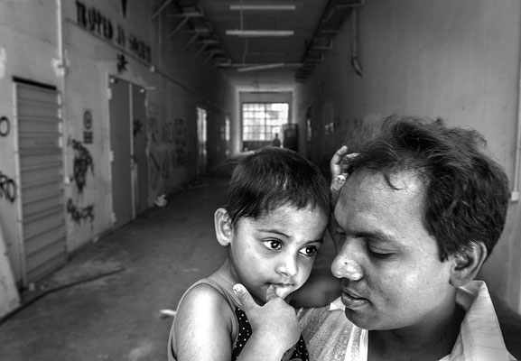 Bangladeshi father and daugther in the occupied 'Area ingovernabile' buildings by migrants political associations of Rome, 2008