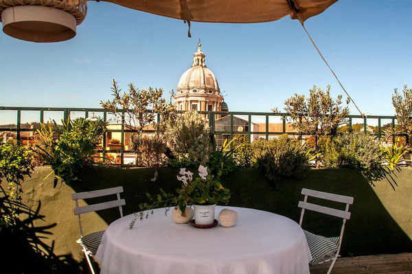 View of the dome of 'San Luca' church, from the terrace of 'Palazzo Ruspoli', a XVI century building in Rome center of old and noble family of Ruspoli. The last level of the big palace is possible to be rented, including the beautiful terrace.