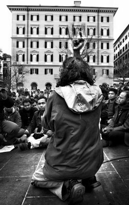 Siddique 'Bachu' Nure Alam, leader of Bangladeshi Dhuumcatu association, speaks at the crowd of immigrants during a demonstration behind the central Basilica di S.Maria Maggiore.