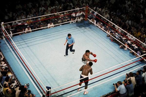 Frazier faces an Ali right hook in their fight at the Araneta Coliseum under the look of referee Carlos Padilla, in Quezon City, Philippines. October 1, 1975 (Neil Leifer/Sport Illustrated)