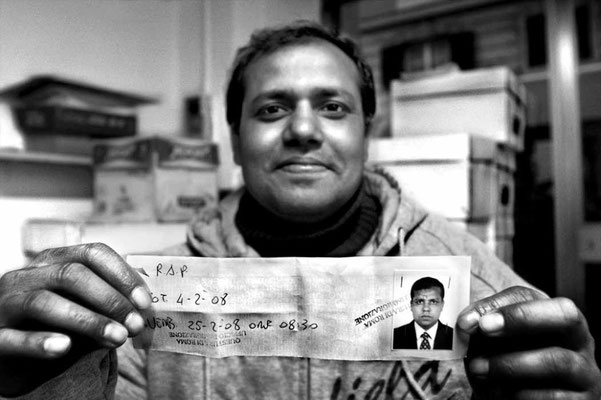 One touched Bangladeshi man shows the first police receipt to get a temporary Humanitarian Residence Permit.