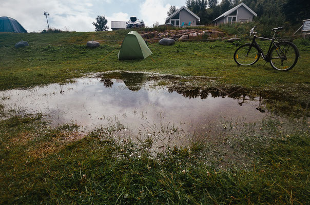 Puddle in which I woke up. In the night I just pulled the tent up the small slope.