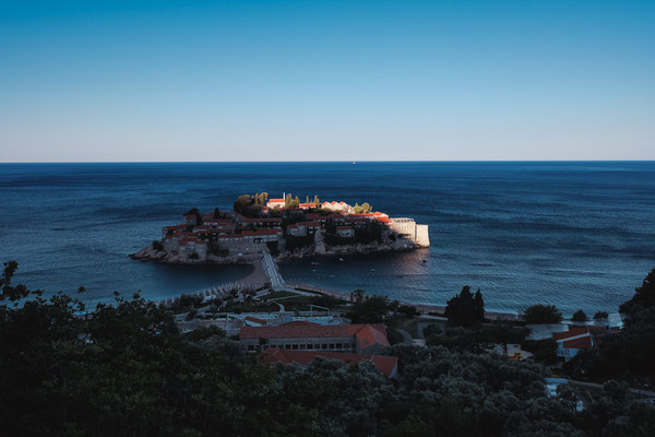 Sveti Stefan with a hint of sun on our way back to the airport