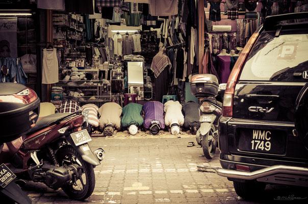 Praying - Kuala Lumpur, Malaysia