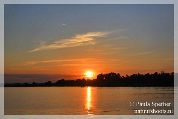 zonsondergang over de Amer