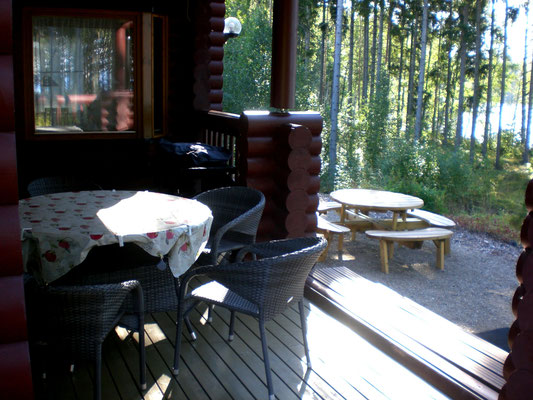 Sunny terrace with BBQ and lake view. 50 m to your own boats at Lake Päijänne