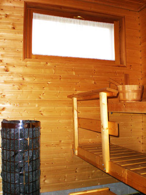 Daylight sauna in the house at the bathroom. Big and heavy electric stove (Own outdoor sauna with wood fired stove directly at the house)