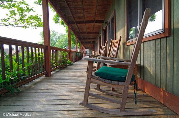 Rocking chairs abound on covered decks