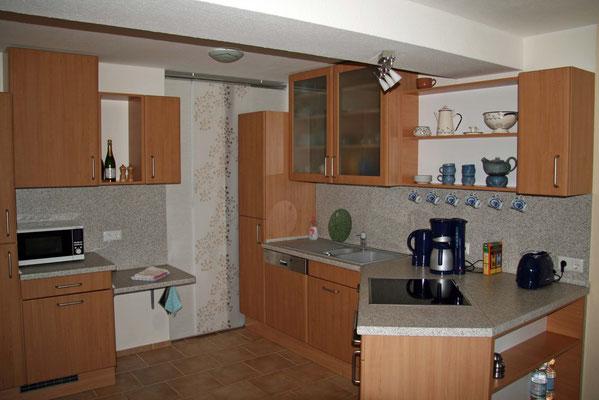 oder sich in der offenen Küche etwas leckeres zum Essen zubereiten.