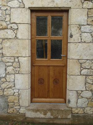 Porte d' entrée en bois de chêne.