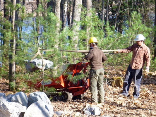 Lifting a rock into a CanyCom toter, Maine Conservation Corps training, Jay, ME, 2012