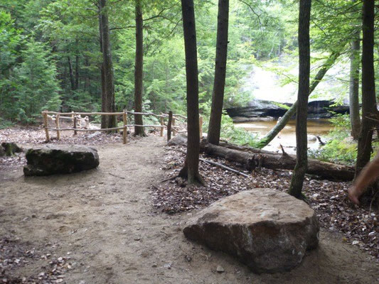 Large boulders acts as natural stone benches overlooking Beede Falls
