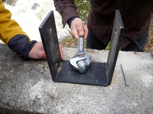 Bolting the bracket into concrete