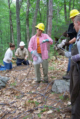 Cleaning and coiling the wire rope, Bear Brook rigging training, Allentown, NH, 2010