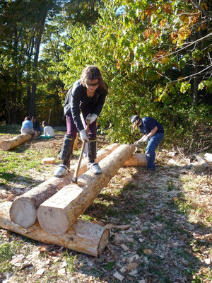 Adzing a log, Timber bridge workshop for the Coastal School for Girls, Wolfe's Neck Farm, Freeport, ME, 2010