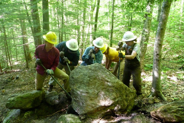 Rolling a large stone, SCA conservation skills training, Walpole, NH, 2011
