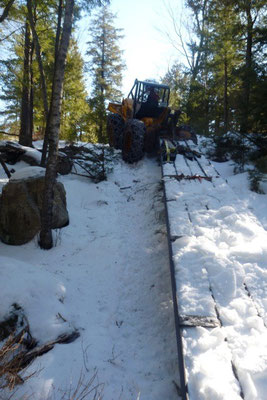 Fred's skidder easily climbs a steep hill with the beams