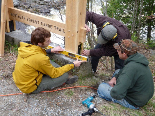 Installing the sign at the Dead River overlook with NFCT Trails Director Walter Opusynski and intern Adam Craten