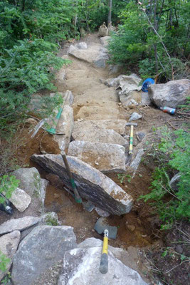 Setting a waterbar rock in the staircase, 2011