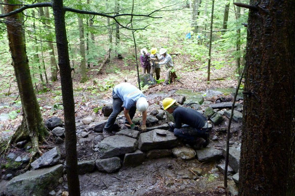 Working on a rock retaining wall, SCA conservation skills training, Walpole, NH, 2011