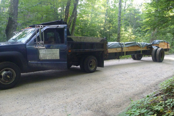 Transporting the steel I-beams and cedar decking for the bridge on a custom made trailer