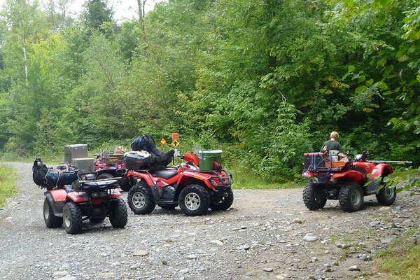 Moving in equipment with ATVs, Mt. Abraham, ME, 2011