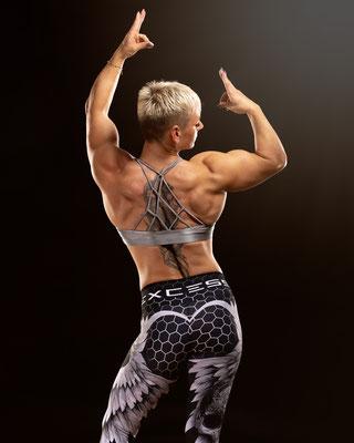 Bodybuilderin Fotografie