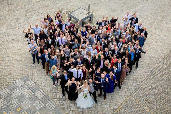 Gruppenfoto in Herzform
