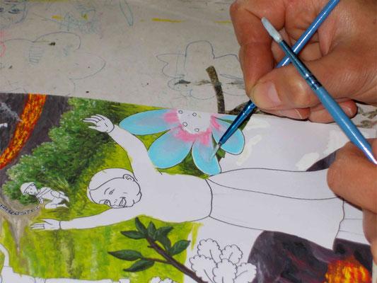 Peindre les éléments du décor à la gouache. Image d'accueil de COBEditions, des BD pédagogiques pour enfants, les aventures de Julie et Beau Prince, par Emmanuelle OLGUIN
