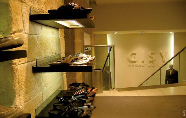 Wandgestaltung im Ladenbau mit Steinpaneele in Burgstein Optik