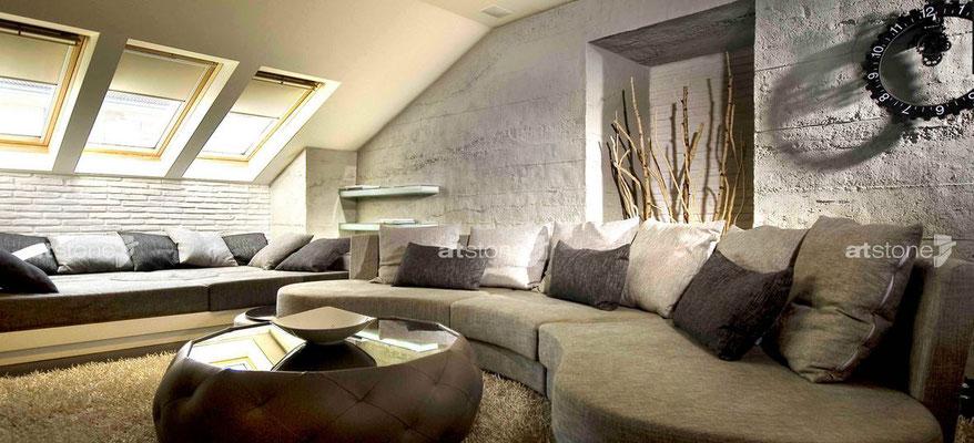 Wohnzimmer mit Sichtbeton- Paneele