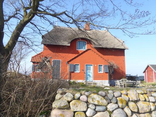 Bild: Rotes Haus auf dem NSG Graswarder