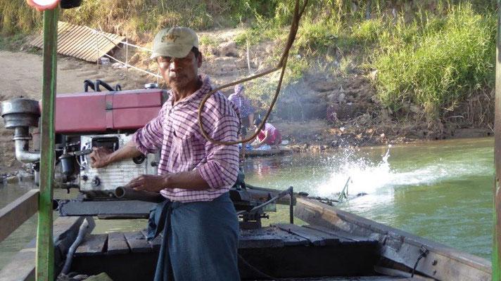 Bild: Fischer auf seinem Boot in Myanmar
