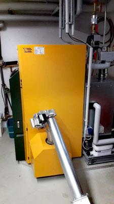 Fördersystem mit Knickschnecke, zum Transport der Pellets in den Verbrennungsraum
