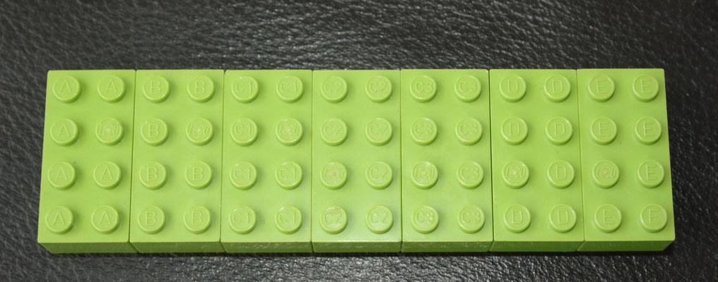 Bayer testbricks. A, B, C1, C2, C3, D, E. LEGO logo on one stud.