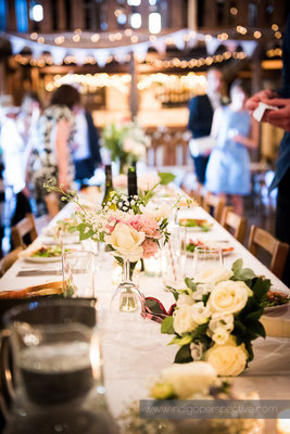 38-westcott-barton-wedding-photography-north-devon-tabel-decorations-rustic-flowers-lights