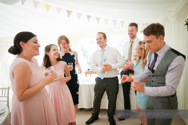 41-weirmarsh-farm-wedding-north-devon-informal-guests-chat-smile