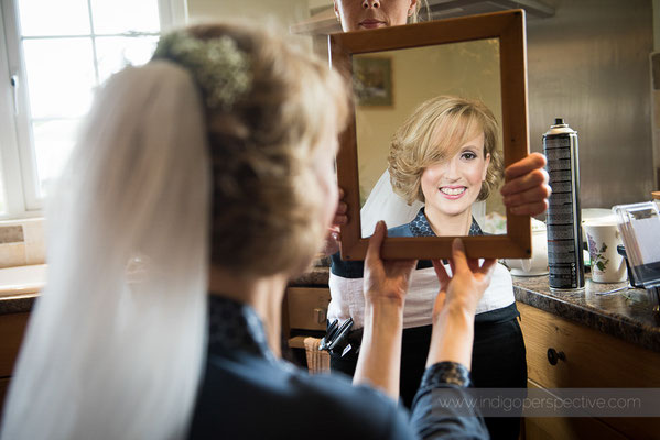 3-woolhanger-manor-wedding-photography-north-devon-bride-makeup-mirror-smile-preparation