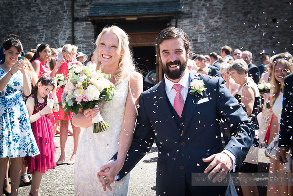 19-westcott-barton-wedding-photography-north-devon-bride-groom-confetti