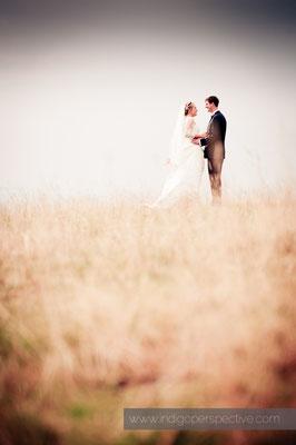 48-woolacombe-barricane-beach-wedding-north-devon-bride-groom-distance-natural-portrait