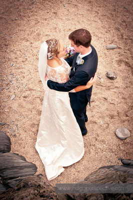 20-woolacombe-barricane-beach-wedding-north-devon-bride-groom-cuddle