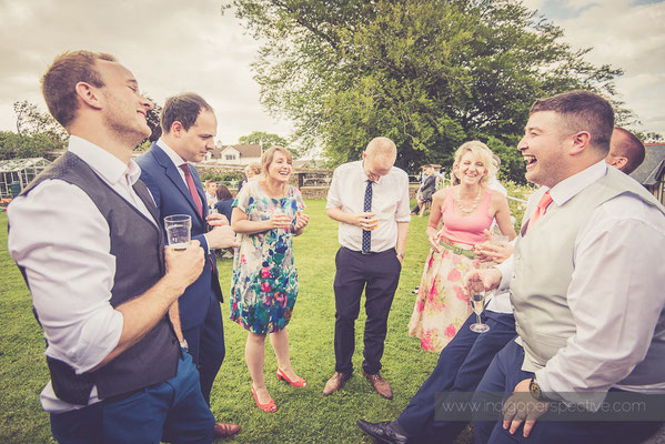 50-woolhanger-manor-wedding-photography-north-devon-guest-laugh-smile