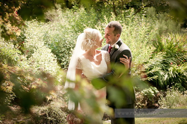 31-weirmarsh-farm-wedding-north-devon-bride-groom intimate-smile-cuddle