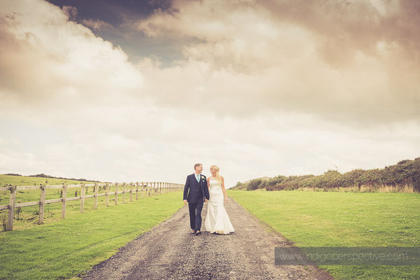 67-ocean-kave-wedding-photography-north-devon-bride-groom-walking