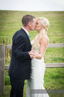57-ocean-kave-wedding-photography-north-devon-bride-groom-kiss-1