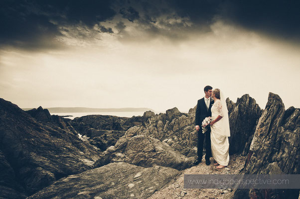 26-woolacombe-barricane-beach-wedding-north-devon-bride-groom-rocks-sea-portrait