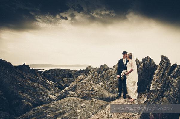 26-woolacombe-barricane-beach-wedding-north-devon-bride-groom-rocks-sea-portrait