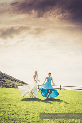 102-ocean-kave-wedding-photography-north-devon-bride-bridesmaid-twirl-dresses