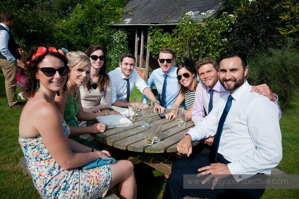 37-weirmarsh-farm-wedding-north-devon-guests-smile-sunshine